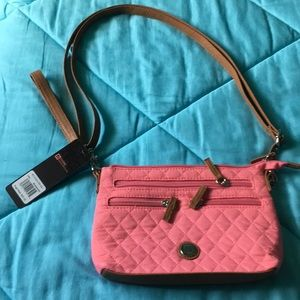 Small purse with 6 zippers great for traveling